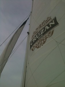PALMETTO BREEE under her main sail and jib sail in team building event.